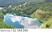 Купить «Aerial video view from drone on Altai natural landscape of Ulagan Plateau with Uchkol mountain lake. Altai, Siberia, Russia», видеоролик № 32184945, снято 24 августа 2019 г. (c) Serg Zastavkin / Фотобанк Лори
