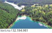Купить «Aerial video view from drone on Altai natural landscape of Ulagan Plateau with Uchkol mountain lake. Altai, Siberia, Russia», видеоролик № 32184981, снято 24 августа 2019 г. (c) Serg Zastavkin / Фотобанк Лори