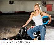 Купить «Woman standing near go-kart cars», фото № 32185097, снято 22 октября 2019 г. (c) Яков Филимонов / Фотобанк Лори