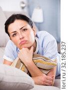 Купить «Portrait of gloomy young woman with pillow», фото № 32185237, снято 2 июня 2017 г. (c) Яков Филимонов / Фотобанк Лори