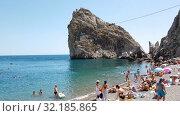 Купить «Simeiz, Crimea - July 1, 2019. Beach near Diva Rock, showplace», видеоролик № 32185865, снято 1 июля 2019 г. (c) Володина Ольга / Фотобанк Лори