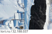 Купить «Aerial video of russian Altai village Semiletka on the bank of river Koksha in winter season», видеоролик № 32188037, снято 1 сентября 2019 г. (c) Serg Zastavkin / Фотобанк Лори