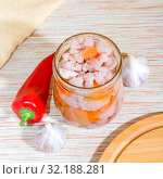 Купить «Homemade canning of summer crops and harvests, vegetable vegetarian diet wholesome food, natural canned cauliflower marinated in a glass jar with garlic, bell pepper and carrots», фото № 32188281, снято 15 сентября 2019 г. (c) Светлана Евграфова / Фотобанк Лори