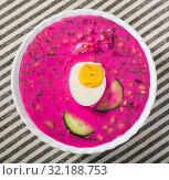 Купить «Cold soup with beetroot on striped tablecloth», фото № 32188753, снято 26 июня 2018 г. (c) Яков Филимонов / Фотобанк Лори