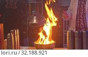 Купить «A man scientist set the substance in the bowl on fire and watching it», видеоролик № 32188921, снято 25 февраля 2020 г. (c) Константин Шишкин / Фотобанк Лори