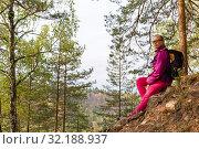 Купить «Woman traveler sat down to rest on a stone», фото № 32188937, снято 15 сентября 2019 г. (c) Евгений Харитонов / Фотобанк Лори