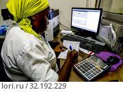 Microfinance institution agency in Ouagadougou, Burkina Faso. Стоковое фото, фотограф Philippe Lissac / Godong / age Fotostock / Фотобанк Лори