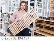Купить «Female buying shelves in store», фото № 32194137, снято 15 января 2018 г. (c) Яков Филимонов / Фотобанк Лори
