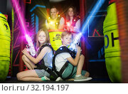 Kids sitting back to back in laser beams. Стоковое фото, фотограф Яков Филимонов / Фотобанк Лори