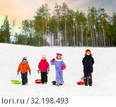 Купить «happy little kids with sleds in winter», фото № 32198493, снято 10 февраля 2018 г. (c) Syda Productions / Фотобанк Лори