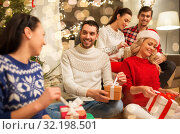 Купить «friends celebrating christmas and opening presents», фото № 32198501, снято 17 декабря 2017 г. (c) Syda Productions / Фотобанк Лори