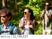 Купить «group of friends with backpacks hiking in forest», фото № 32198637, снято 15 июня 2019 г. (c) Syda Productions / Фотобанк Лори