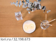 Купить «aroma reed diffuser, burning candle and perfume», фото № 32198673, снято 12 апреля 2019 г. (c) Syda Productions / Фотобанк Лори