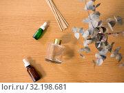 Купить «aroma reed diffuser, essential oil and eucalyptus», фото № 32198681, снято 12 апреля 2019 г. (c) Syda Productions / Фотобанк Лори