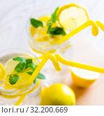 Купить «Glasss of mojito with lemon and drinking straw», фото № 32200669, снято 22 ноября 2017 г. (c) Elnur / Фотобанк Лори