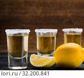 Купить «Tequila drink served in glasses with lime and salt», фото № 32200841, снято 18 сентября 2017 г. (c) Elnur / Фотобанк Лори