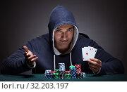Купить «Young man wearing a hoodie with cards and chips gambling», фото № 32203197, снято 19 января 2017 г. (c) Elnur / Фотобанк Лори