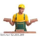 Купить «The handsome construction worker building brick wall», фото № 32203289, снято 5 ноября 2016 г. (c) Elnur / Фотобанк Лори