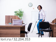 Купить «Young male employee unhappy with excessive work», фото № 32204353, снято 24 мая 2019 г. (c) Elnur / Фотобанк Лори