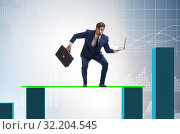 Купить «Young businessman in business concept with bar charts», фото № 32204545, снято 18 октября 2019 г. (c) Elnur / Фотобанк Лори