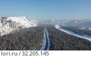 Купить «Aerial video of Altai country forest road on the bank of river Katun in winter. Altai, Siberia, Russia», видеоролик № 32205145, снято 2 сентября 2019 г. (c) Serg Zastavkin / Фотобанк Лори