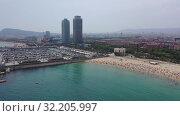 Купить «Panoramic view from the drone of coastline and beach of Barcelona. Spain», видеоролик № 32205997, снято 7 июля 2019 г. (c) Яков Филимонов / Фотобанк Лори