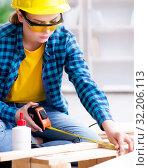 Female repairman carpenter cutting joining wooden planks doing r. Стоковое фото, фотограф Elnur / Фотобанк Лори