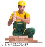 Купить «The handsome construction worker building brick wall», фото № 32206497, снято 5 ноября 2016 г. (c) Elnur / Фотобанк Лори