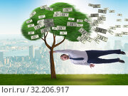 Купить «Businessman blown away from the money tree», фото № 32206917, снято 31 марта 2020 г. (c) Elnur / Фотобанк Лори