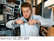 Купить «Engineer connects wires under tension in lab», фото № 32207269, снято 17 июня 2019 г. (c) Tryapitsyn Sergiy / Фотобанк Лори