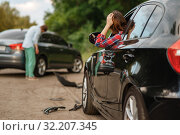 Male and female drivers after car accident on road. Стоковое фото, фотограф Tryapitsyn Sergiy / Фотобанк Лори