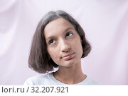 Купить «Portrait of a brown-Eyed girl on a pink background, eyes looking up», фото № 32207921, снято 31 августа 2019 г. (c) Катерина Белякина / Фотобанк Лори