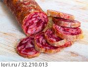 Купить «Appetizing salchichon sausage on wooden table», фото № 32210013, снято 19 октября 2019 г. (c) Яков Филимонов / Фотобанк Лори
