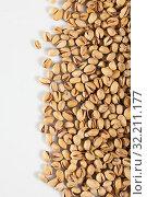 Купить «Dried kernels of pistachios», фото № 32211177, снято 20 января 2020 г. (c) Яков Филимонов / Фотобанк Лори