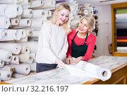 Купить «Woman seller is showing fabrics to female customers», фото № 32216197, снято 15 февраля 2017 г. (c) Яков Филимонов / Фотобанк Лори