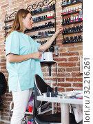 Купить «nail master standing at working place», фото № 32216261, снято 30 мая 2018 г. (c) Яков Филимонов / Фотобанк Лори
