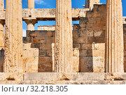 Купить «Columns of ancient temple of Aphaea», фото № 32218305, снято 13 сентября 2019 г. (c) Роман Сигаев / Фотобанк Лори