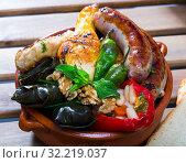 Купить «Tasty bulgarian kapama with grape rolls, sausage, chicken and stuffed pepper», фото № 32219037, снято 15 декабря 2019 г. (c) Яков Филимонов / Фотобанк Лори