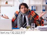 Купить «Man with flu working in the office», фото № 32222517, снято 6 декабря 2018 г. (c) Elnur / Фотобанк Лори