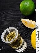 Купить «Tequila drink served in glasses with lime and salt», фото № 32222901, снято 18 сентября 2017 г. (c) Elnur / Фотобанк Лори