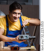Купить «Worker working in repair workshop in woodworking concept», фото № 32223053, снято 11 августа 2017 г. (c) Elnur / Фотобанк Лори