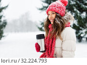 Купить «young woman with hot drink in tumbler in winter», фото № 32224793, снято 29 января 2019 г. (c) Syda Productions / Фотобанк Лори