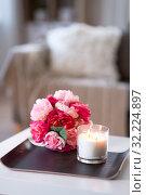 Купить «burning fragrance candle and flower bunch at home», фото № 32224897, снято 12 апреля 2019 г. (c) Syda Productions / Фотобанк Лори