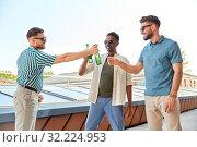 Купить «happy male friends drinking beer at rooftop party», фото № 32224953, снято 21 июля 2019 г. (c) Syda Productions / Фотобанк Лори
