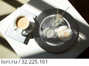 Купить «coffee, candles and aroma reed diffuser on table», фото № 32225161, снято 11 апреля 2019 г. (c) Syda Productions / Фотобанк Лори
