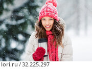 Купить «young woman with hot drink in tumbler in winter», фото № 32225297, снято 29 января 2019 г. (c) Syda Productions / Фотобанк Лори