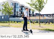 Купить «businessman with backpack riding electric scooter», фото № 32225345, снято 1 августа 2019 г. (c) Syda Productions / Фотобанк Лори