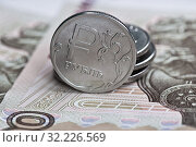 Купить «Деньги. Российские рубли: монетки на фоне сторублевых банкнот», фото № 32226569, снято 10 августа 2019 г. (c) E. O. / Фотобанк Лори