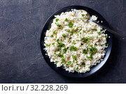 Cauliflower rice or couscous in a bowl. Стоковое фото, фотограф Oksana Zh / Фотобанк Лори