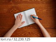 Купить «Character Child Writing in Blank Notebook Flat Lay», фото № 32230125, снято 25 марта 2019 г. (c) Иван Карпов / Фотобанк Лори